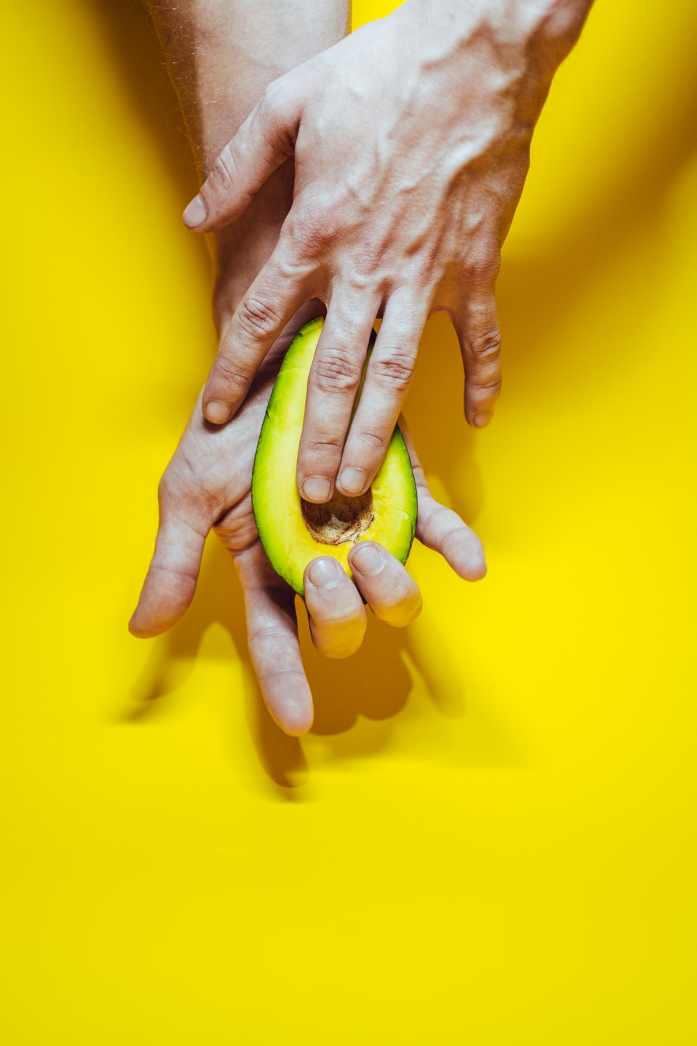 persons hand on yellow surface