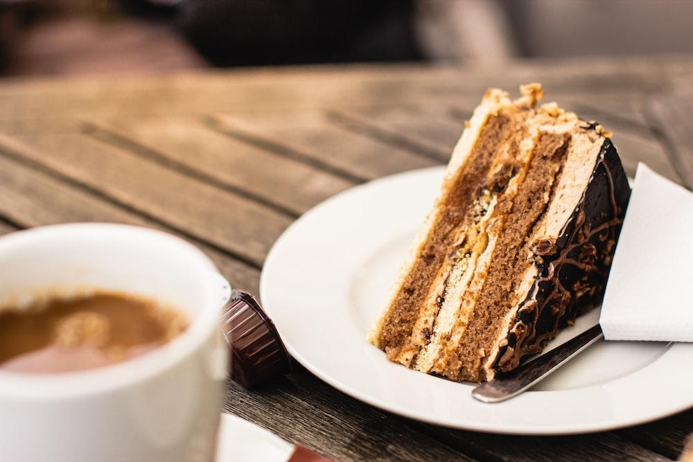 brown and black sliced cake on white ceramic plate