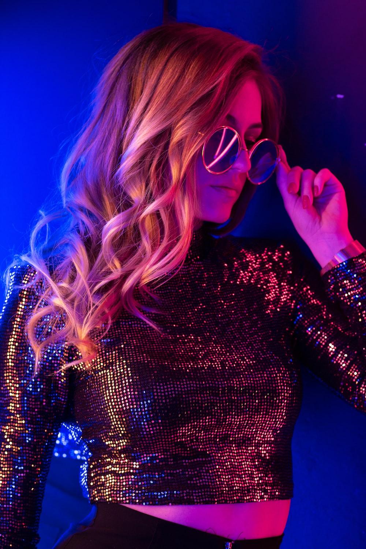 woman in black long sleeve shirt wearing sunglasses