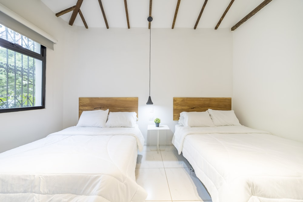 white bed linen on bed