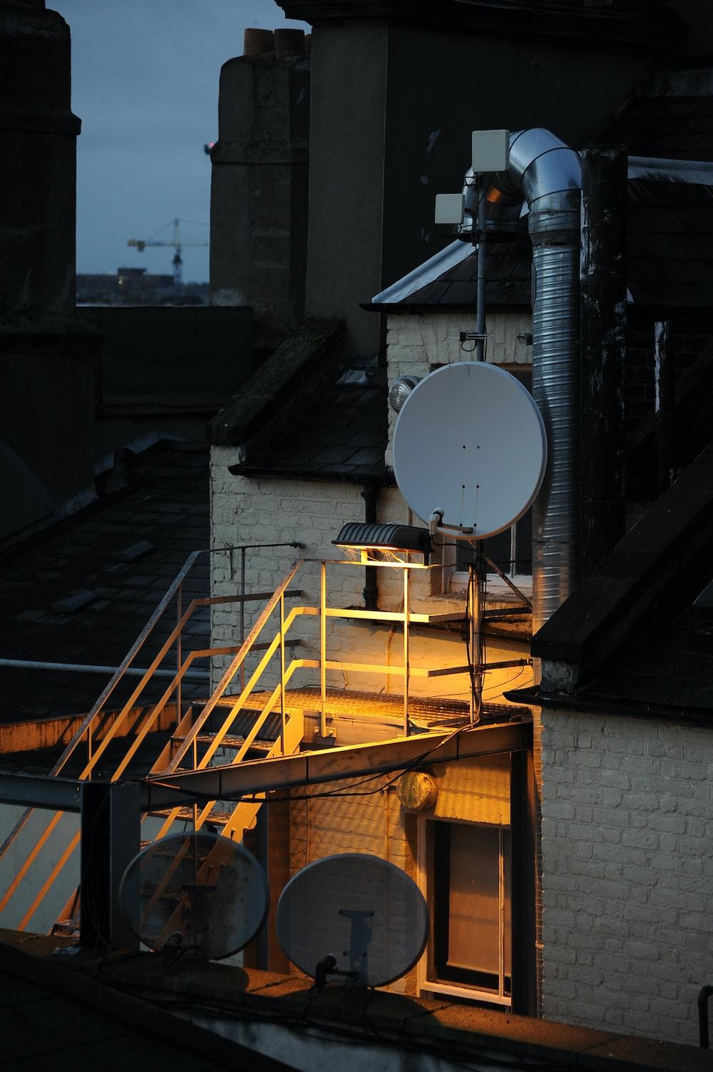 white satellite dish on brown wooden ladder