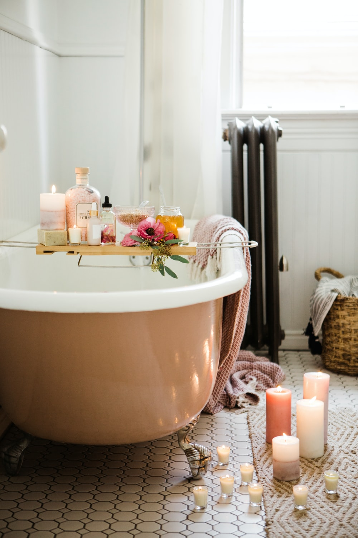 white ceramic bathtub with water