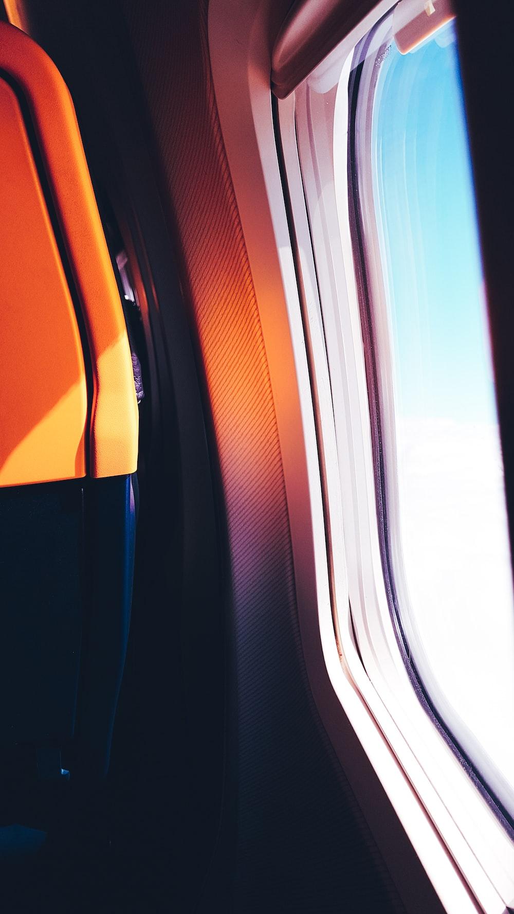 black and orange airplane window