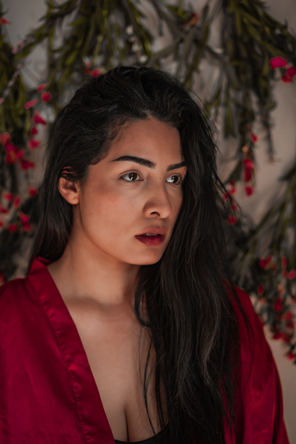 woman in red shirt with black hair