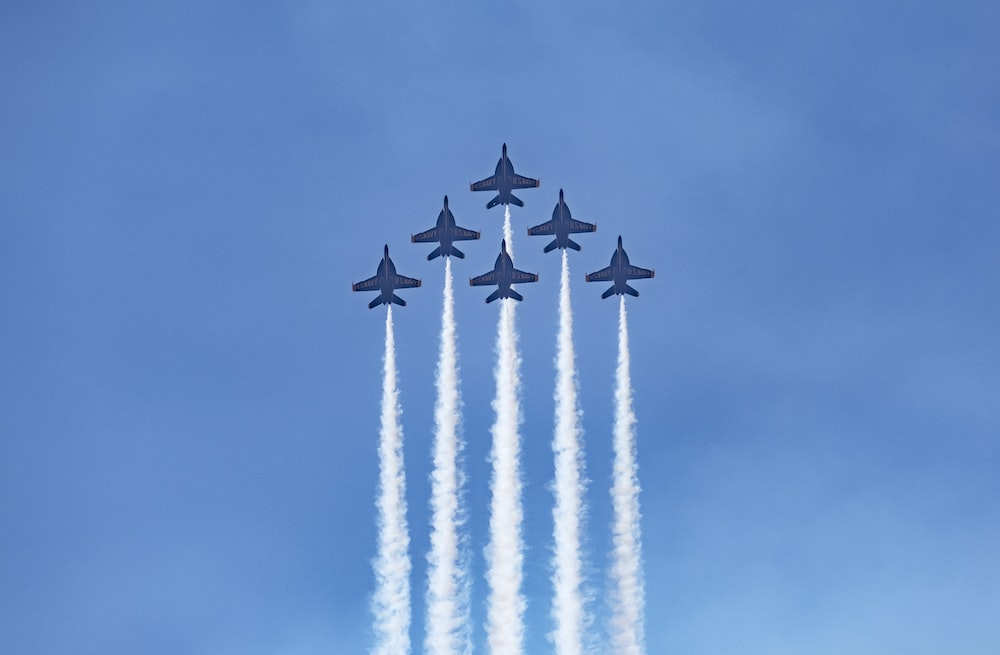 four jet planes in mid air