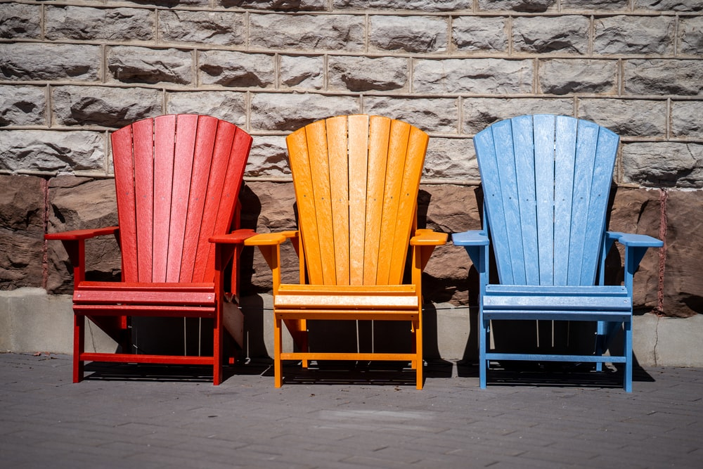 red and blue wooden armchairs