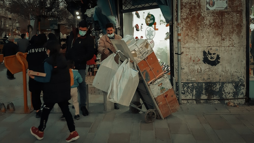 people standing near white and brown cardboard boxes
