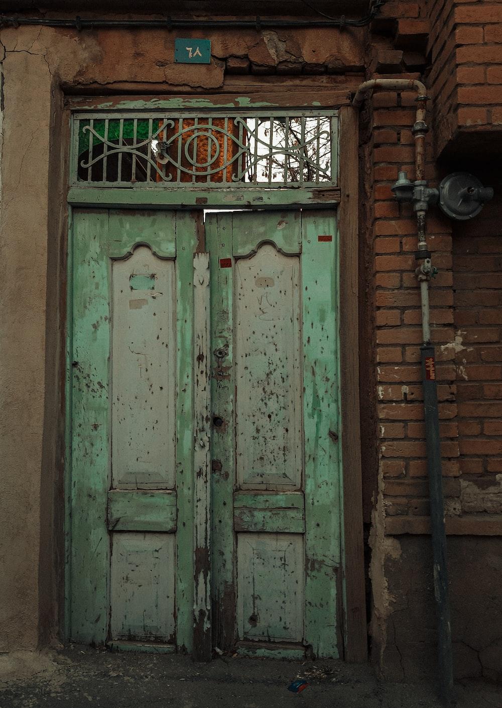 white wooden door with black steel door lever