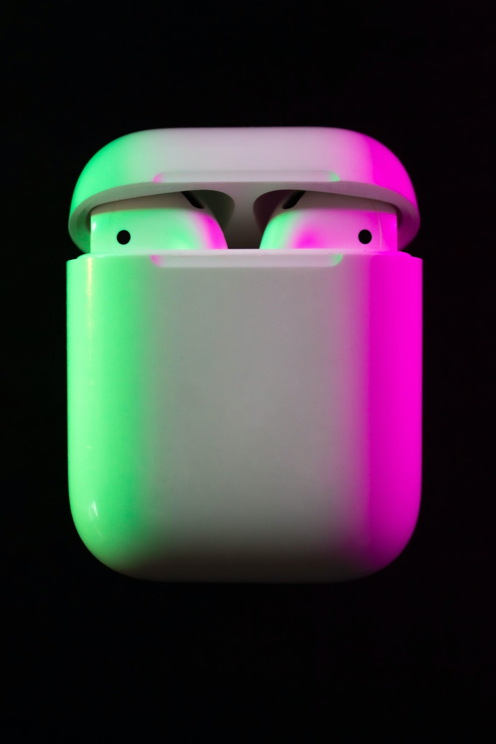 AirPods on a black background