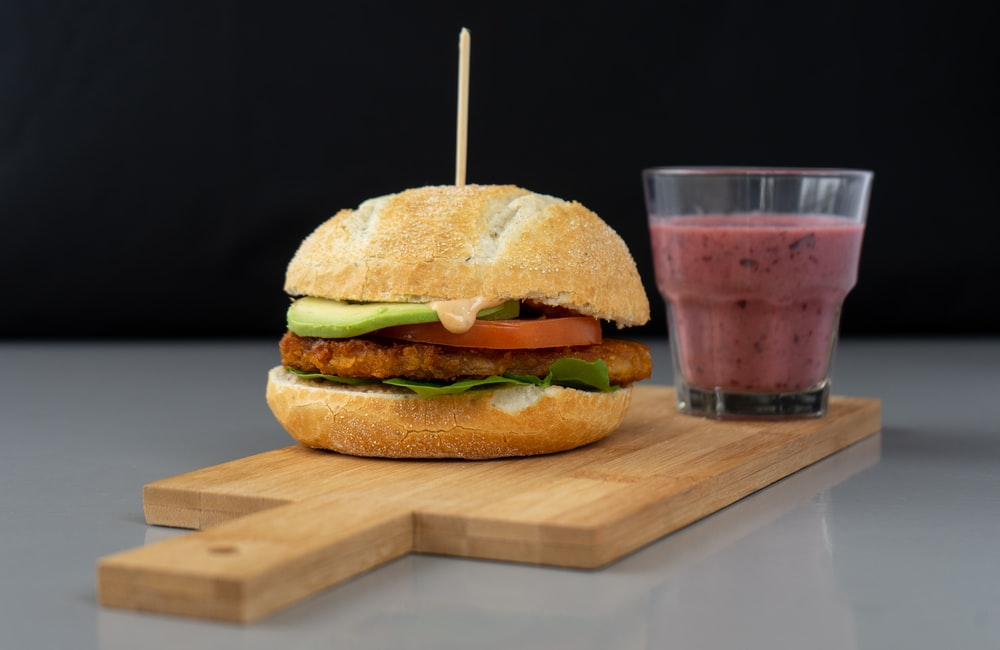 burger on brown wooden table