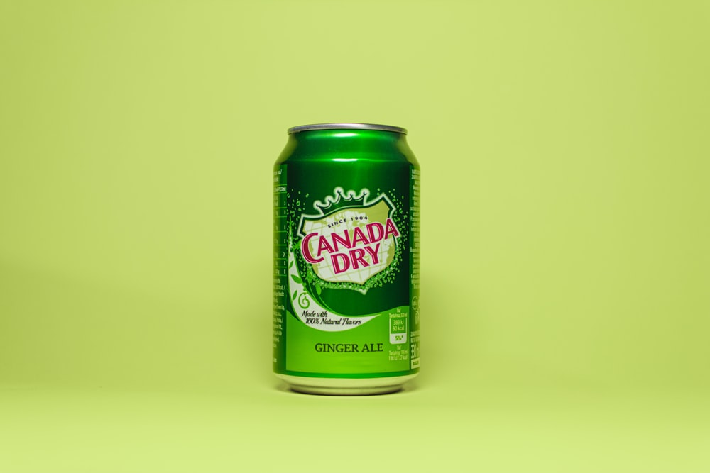 green and white labeled can