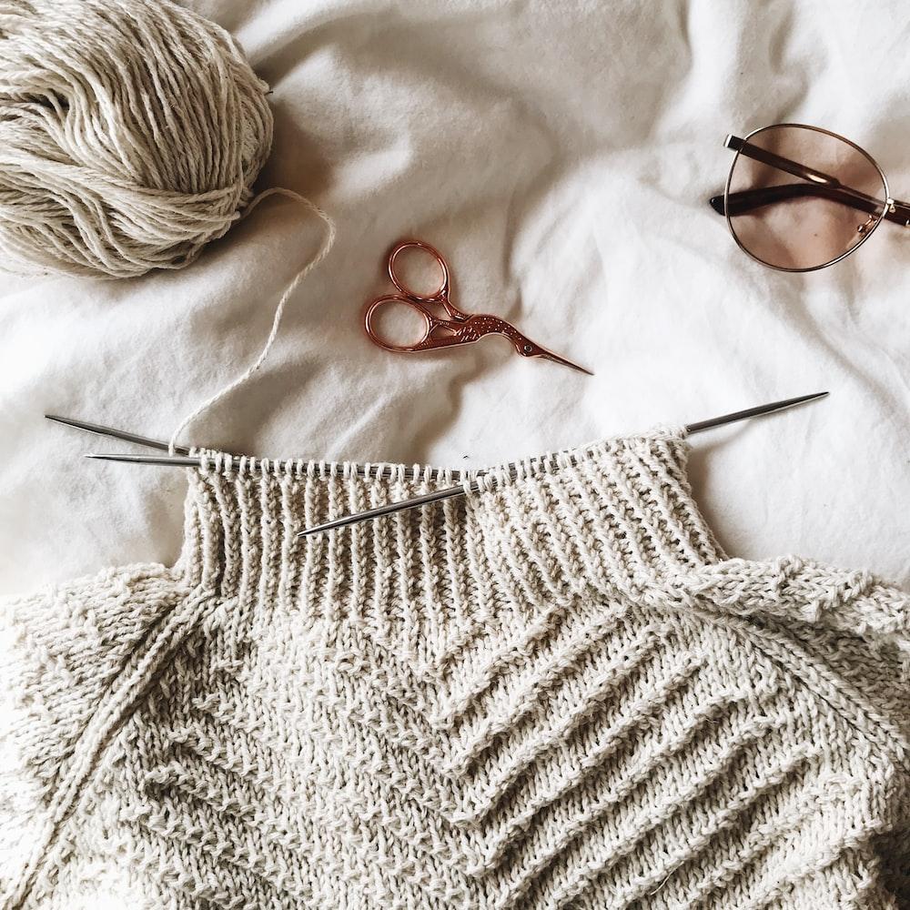 brown framed sunglasses on white knit textile