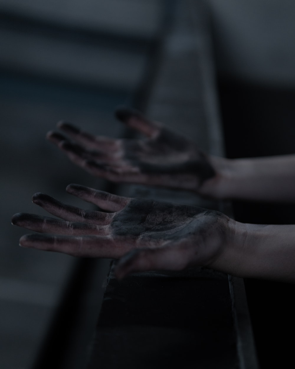 persons left hand with black paint