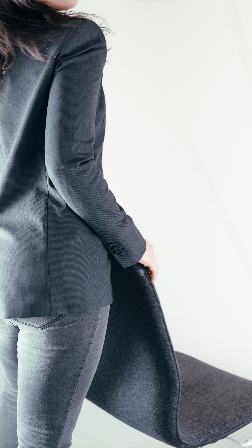 person in gray blazer and white dress pants