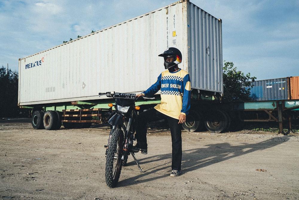 man in black jacket riding on black motorcycle during daytime