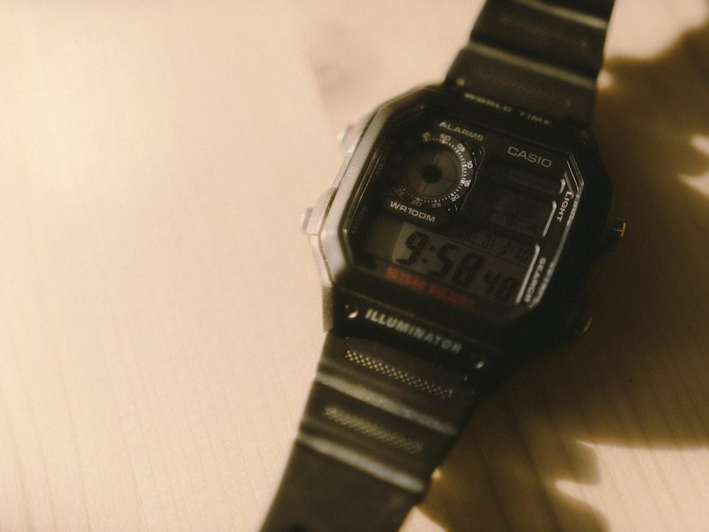 black casio digital watch at 7 00