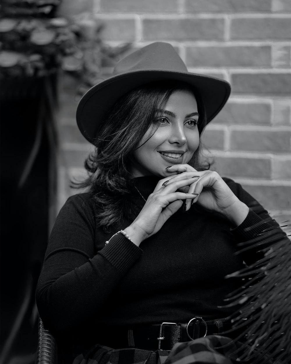 woman in black long sleeve shirt wearing black hat