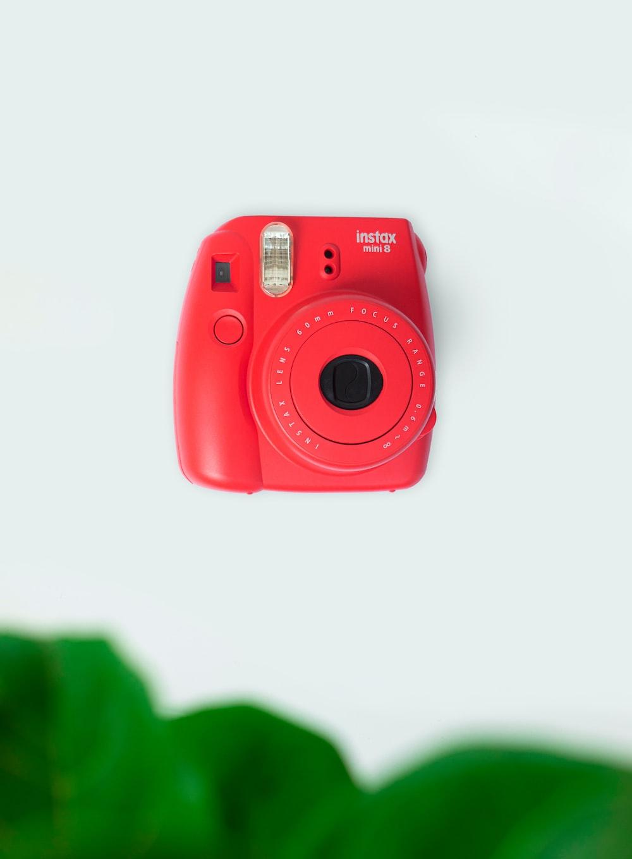 red nikon point and shoot camera