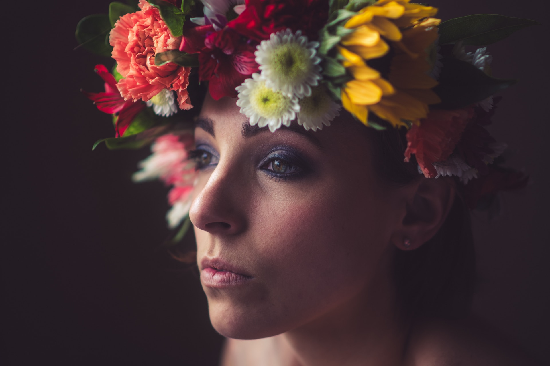 woman with yellow and red flower on her head