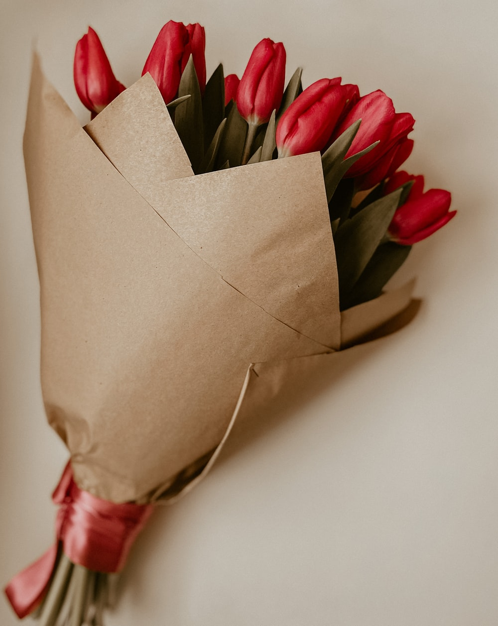 red and green flower petals on brown paper bag