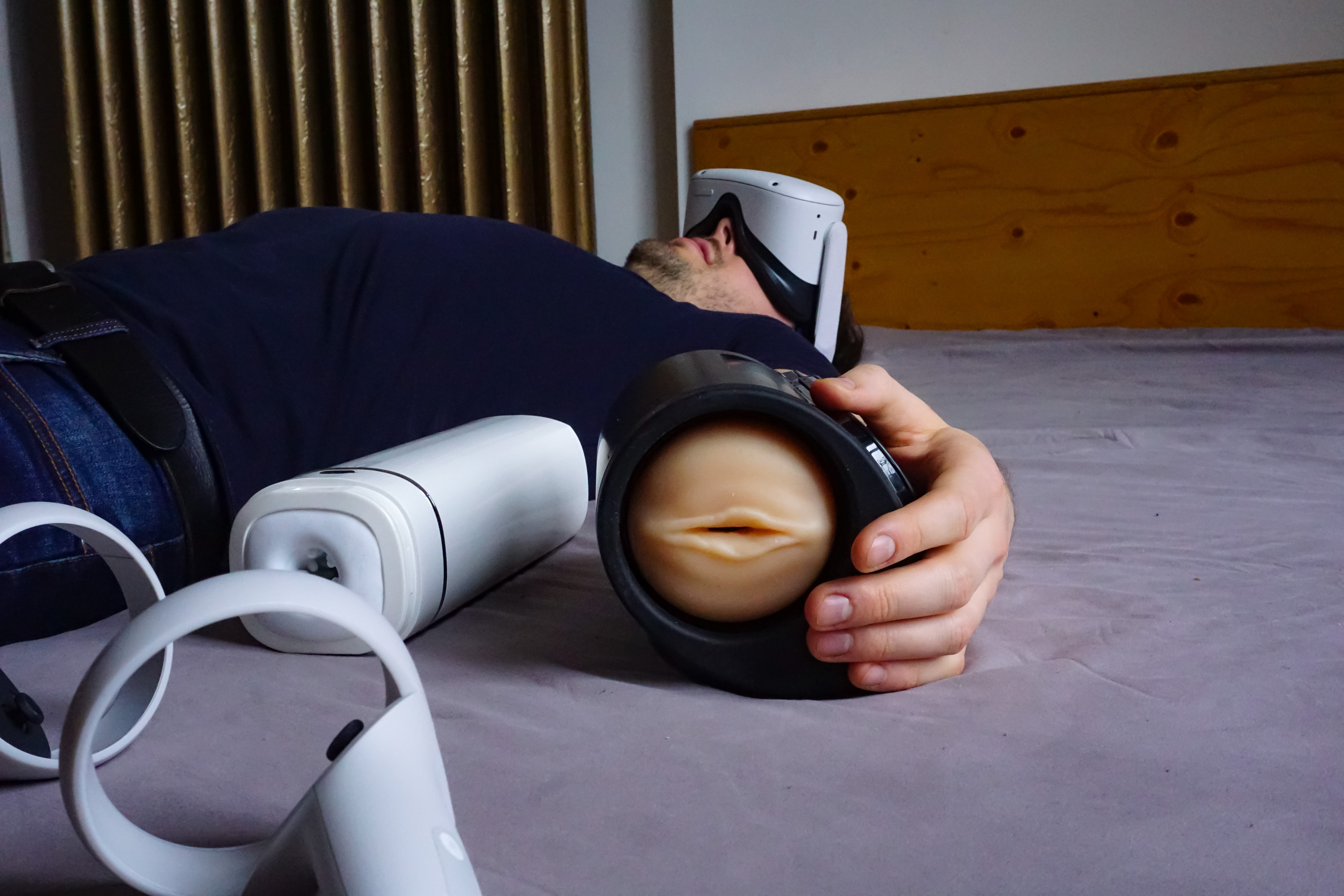 man wearing virtual reality headset and holding sex toy
