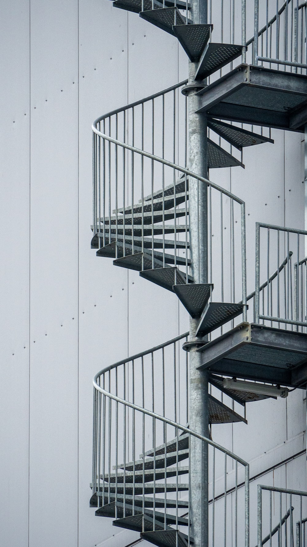 white spiral staircase with white wall