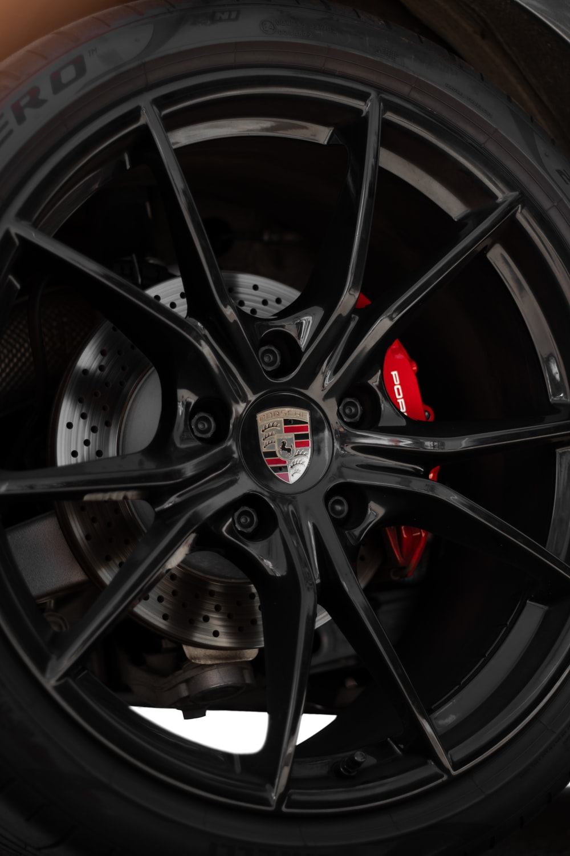 black and silver 5 spoke car wheel