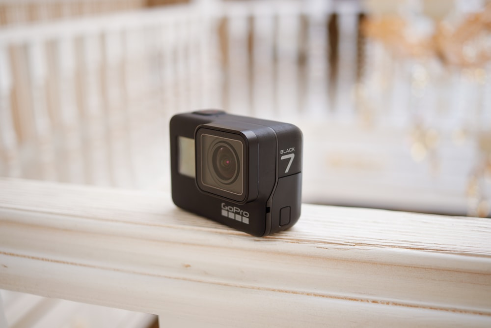 black camera on white wooden table