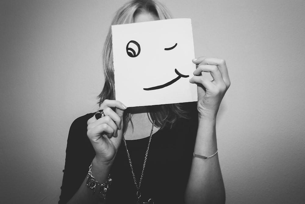 woman holding white printer paper