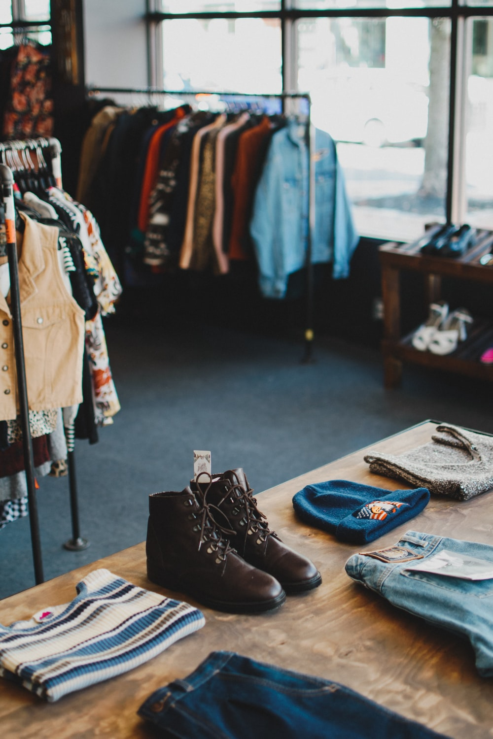 brown leather boots on brown wooden table