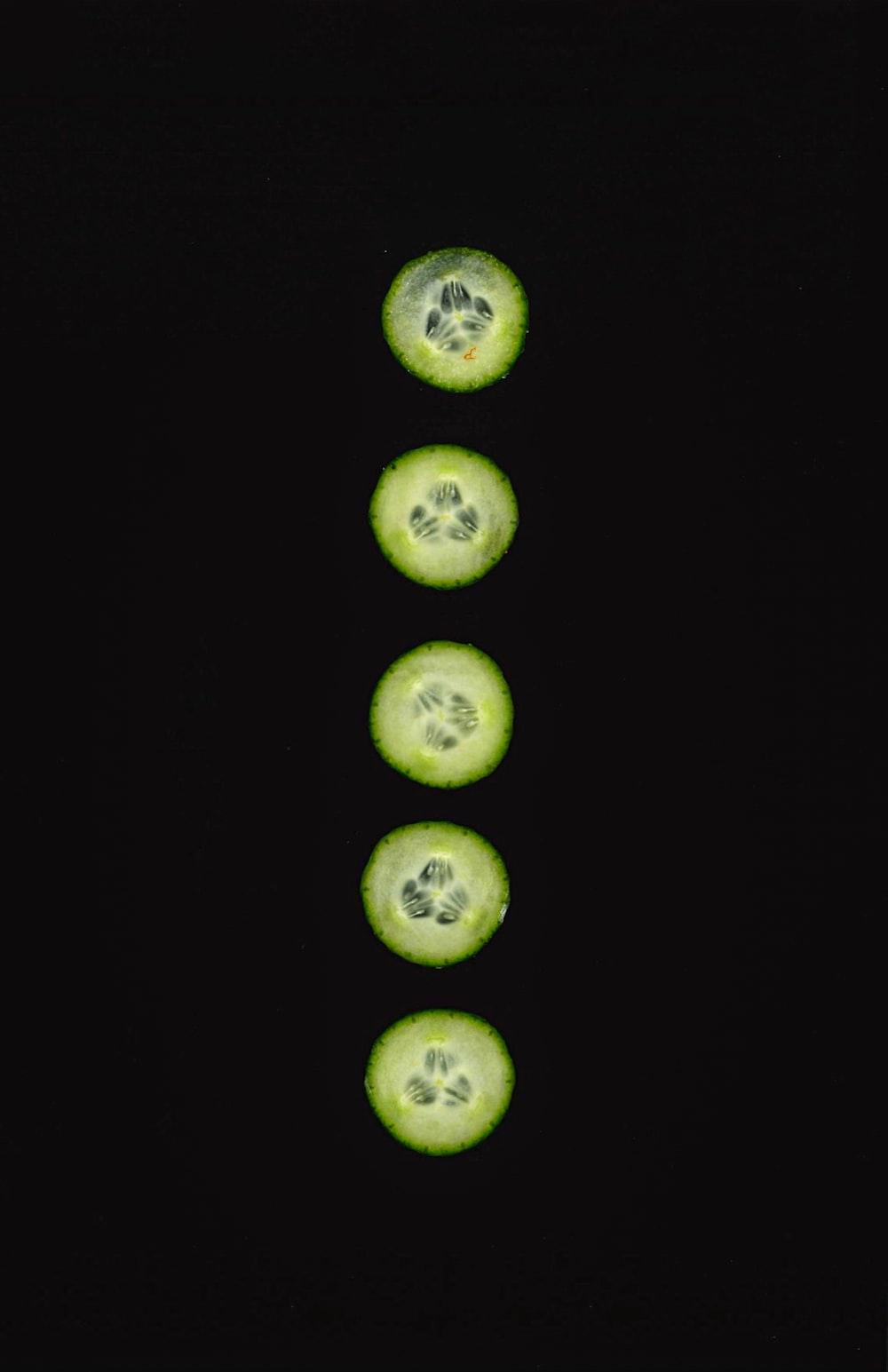 3 sliced green citrus fruits