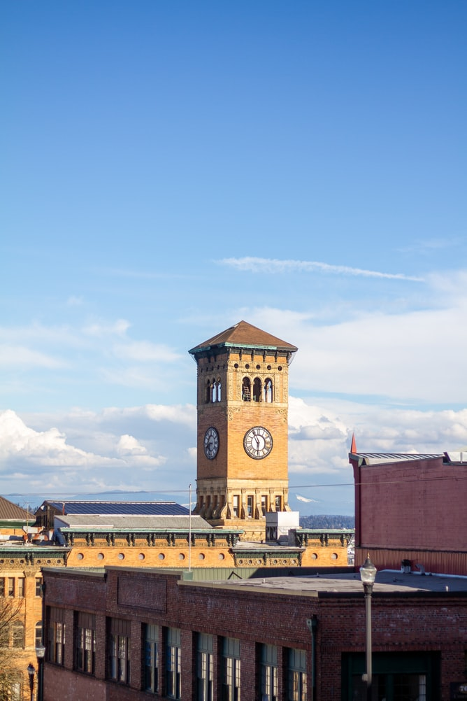 Old City Hall Clock Tower seen against a blue sky