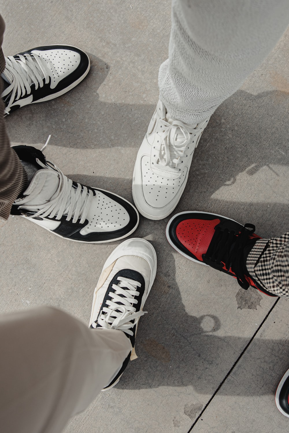 person wearing white and red nike sneakers