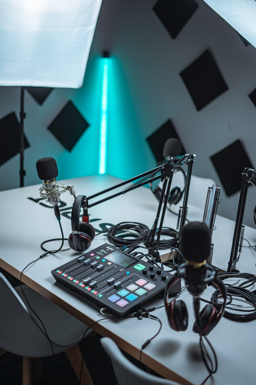 black audio mixer near black microphone