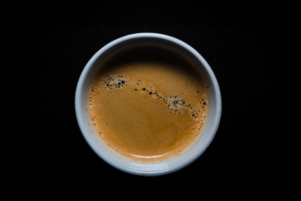 brown liquid in white ceramic mug