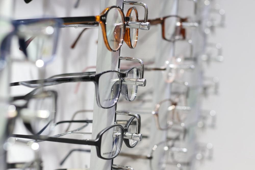 silver framed eyeglasses on clear glass