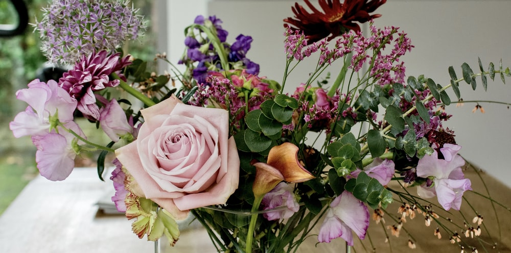 pink roses and purple flowers