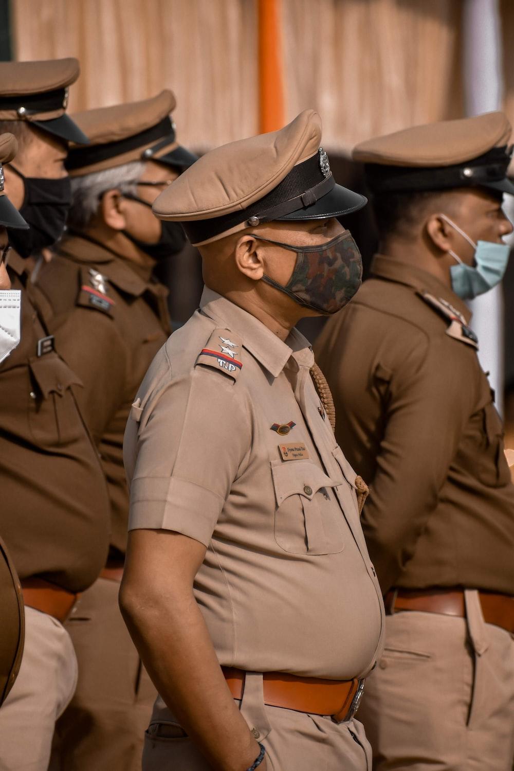 man in brown uniform sitting on chair