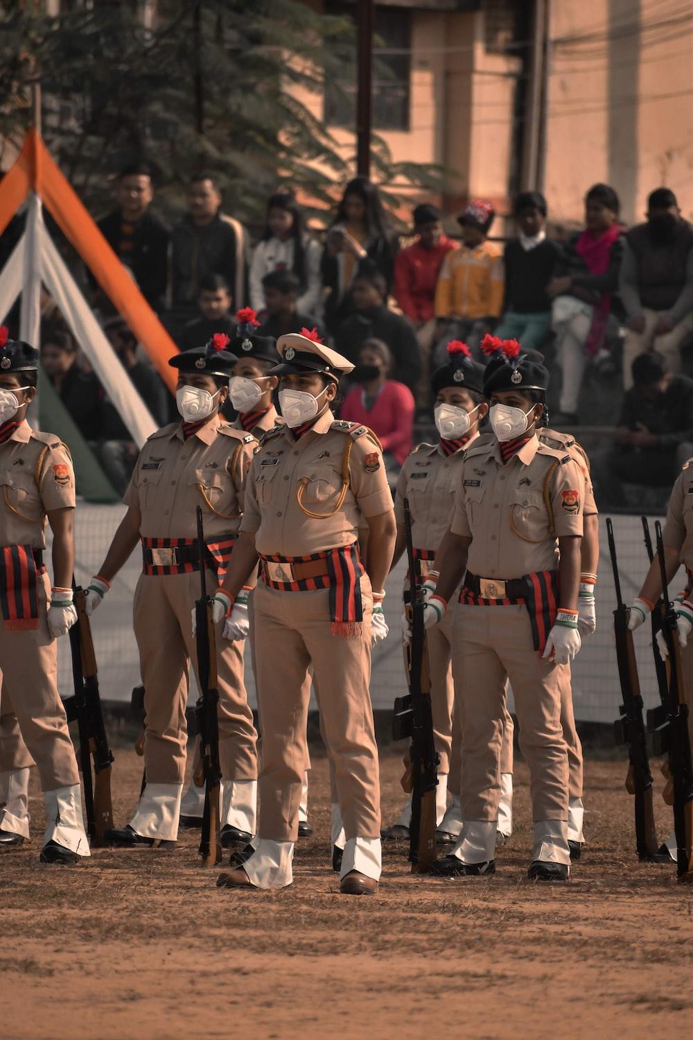 men in brown uniform standing during daytime