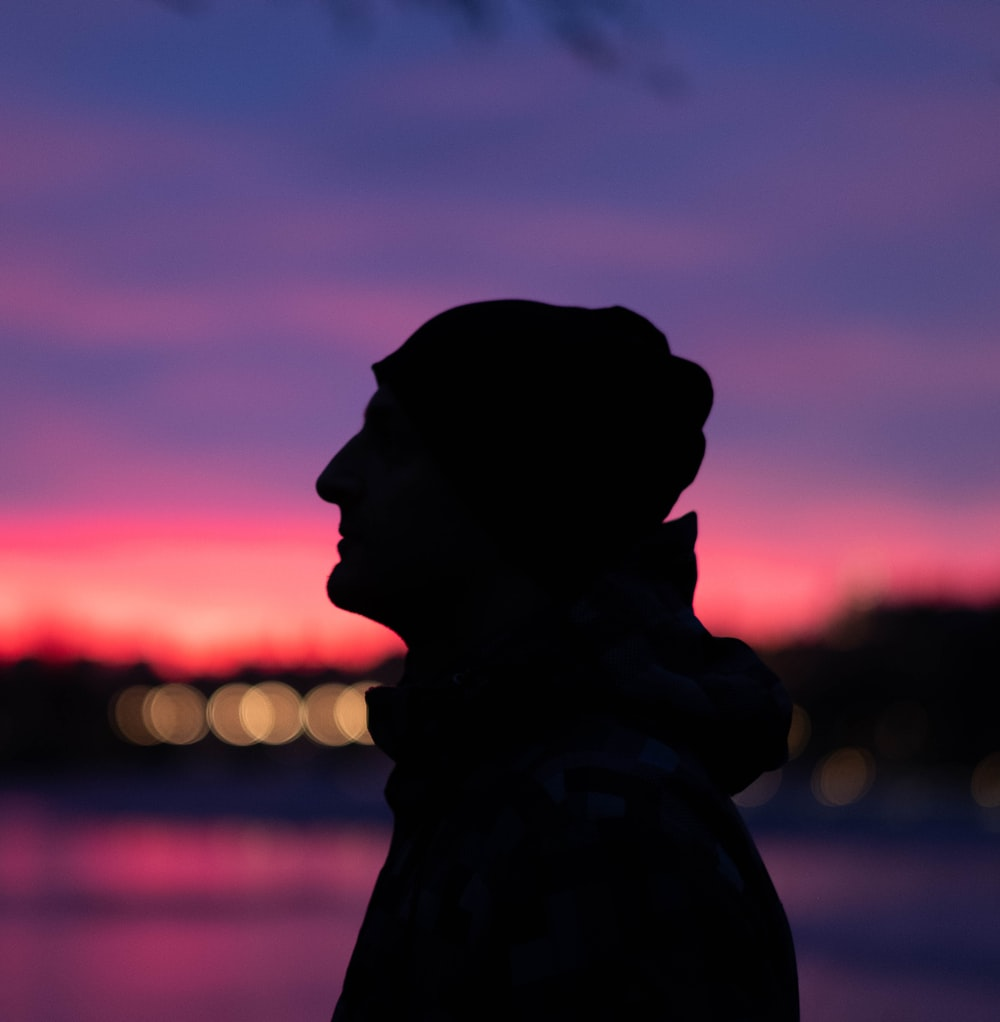 silhouette of man with hoodie during sunset