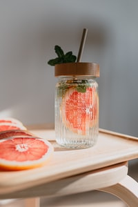 sliced orange fruit in clear glass jar
