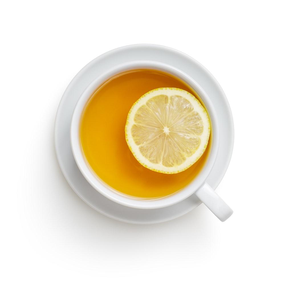 white ceramic mug with lemon juice