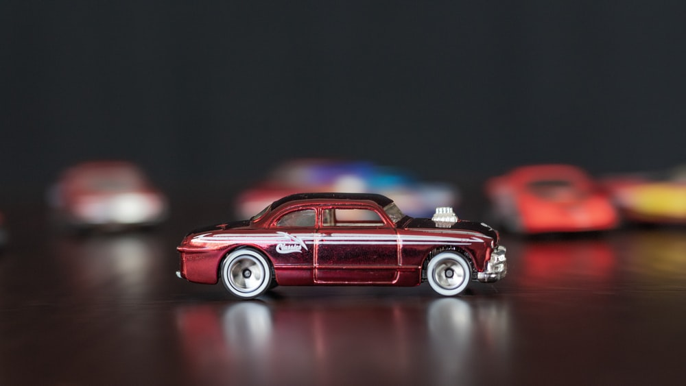 red and white vintage car scale model
