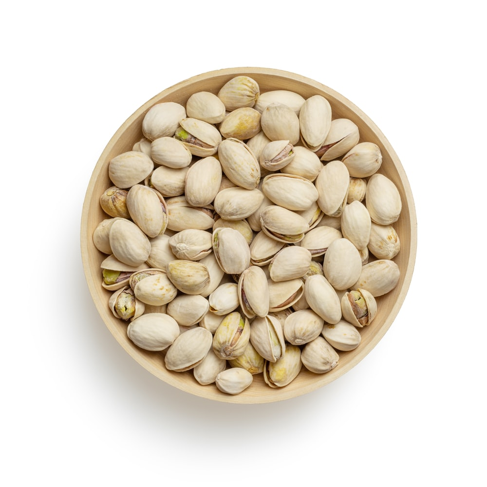 brown wooden round bowl with white beans