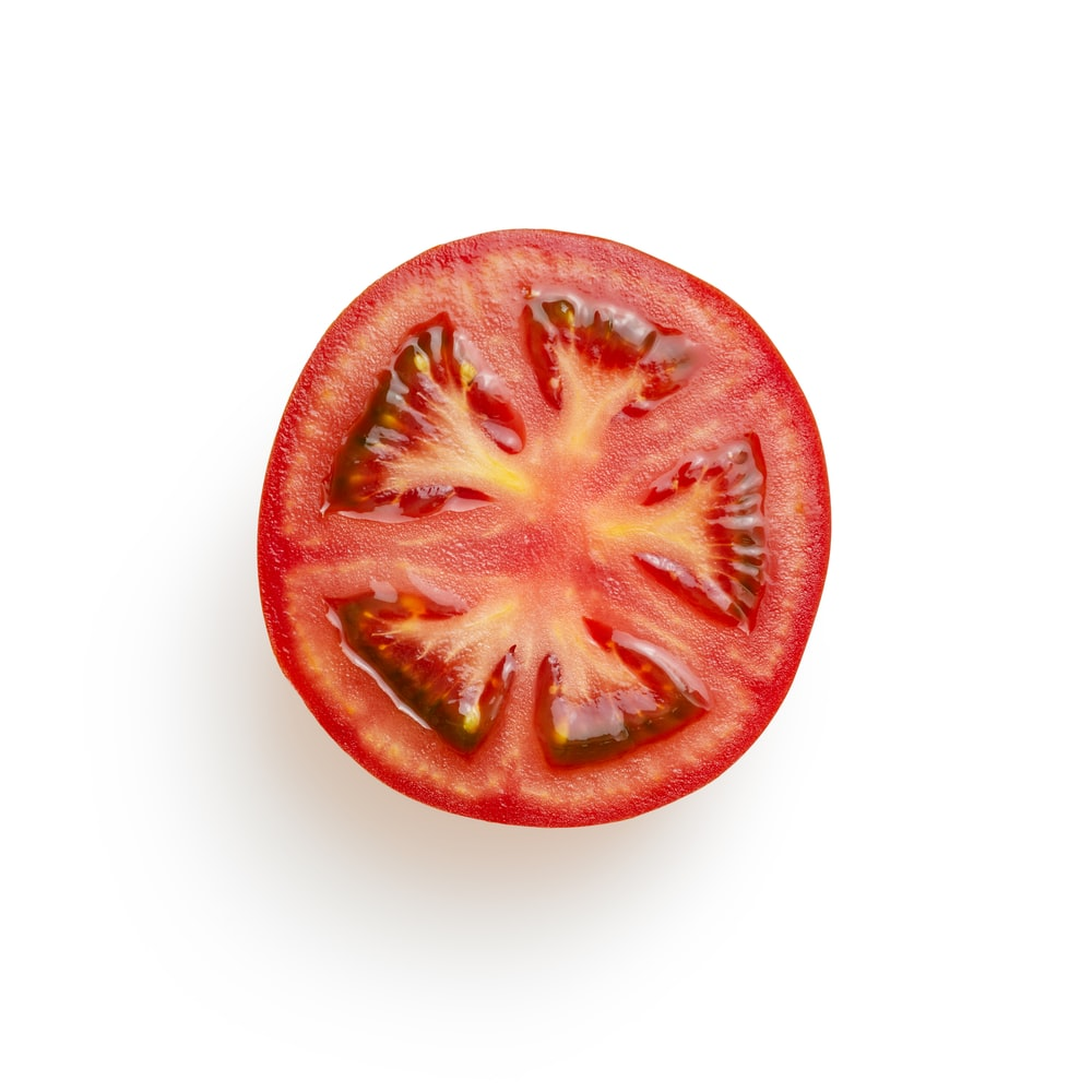sliced tomato on white surface