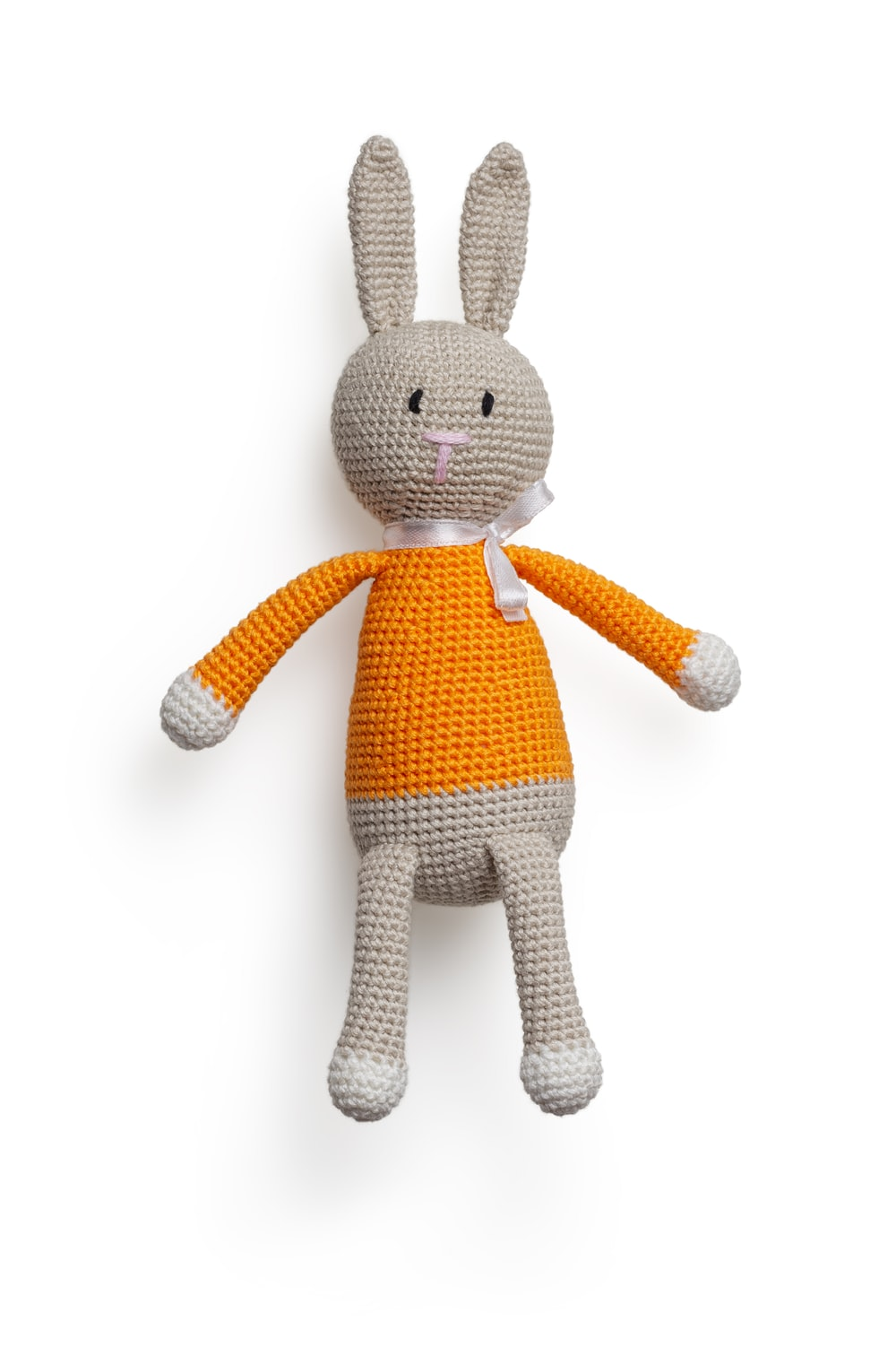 white and yellow rabbit plush toy