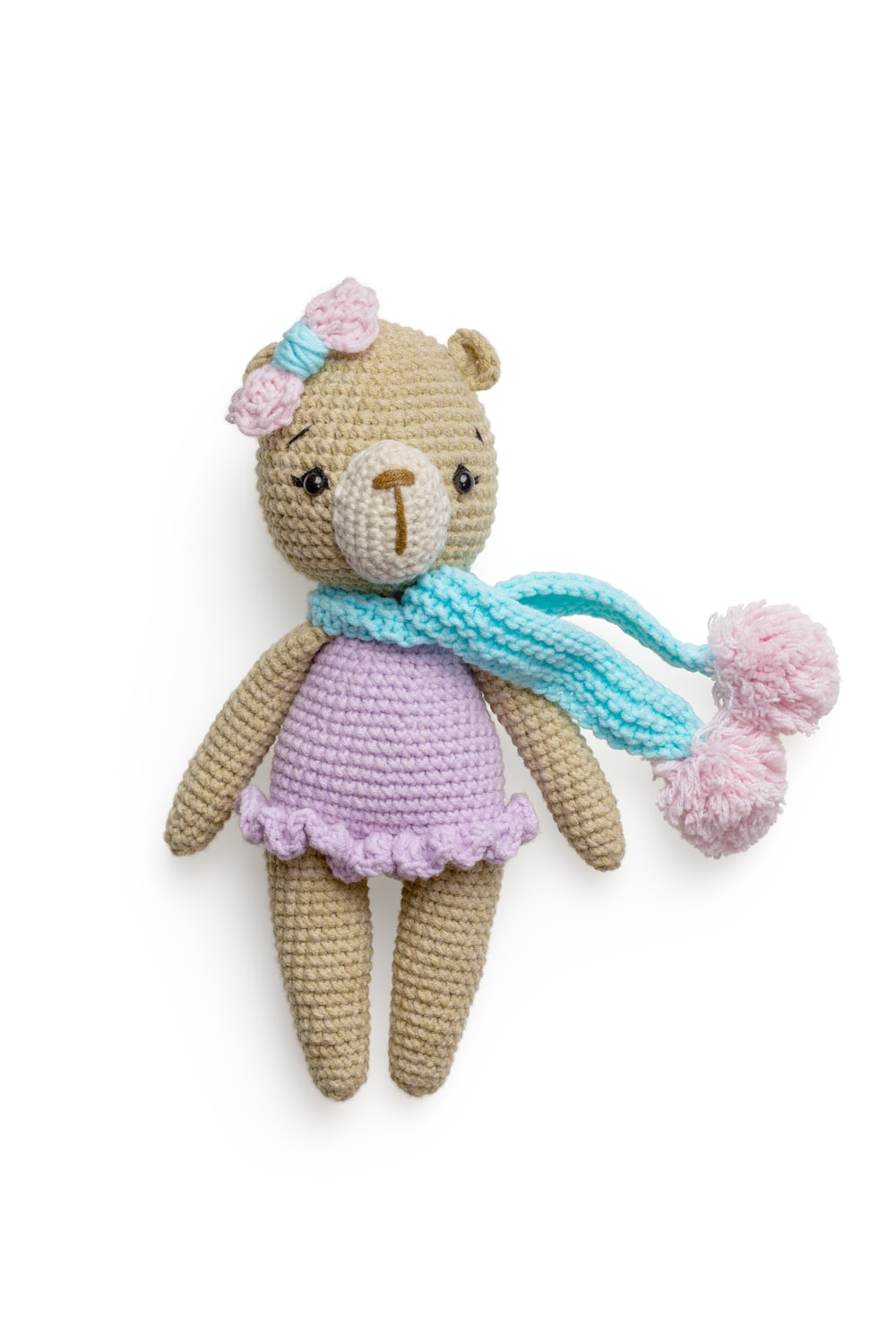 pink bear plush toy with pink scarf