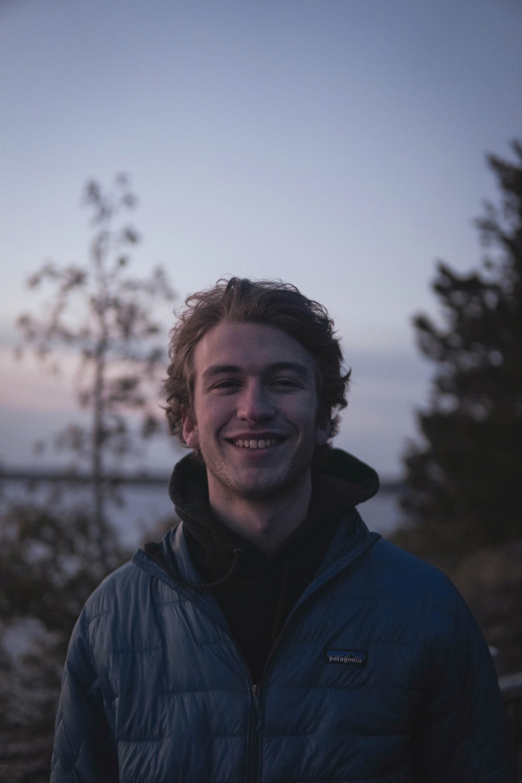 man in blue jacket smiling