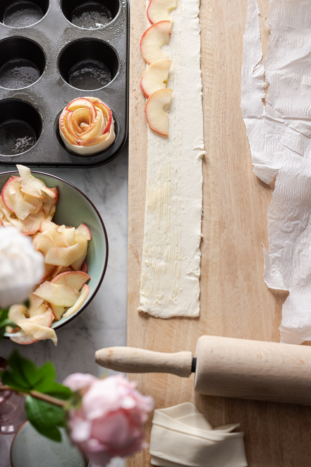 white rose on brown wooden chopping board