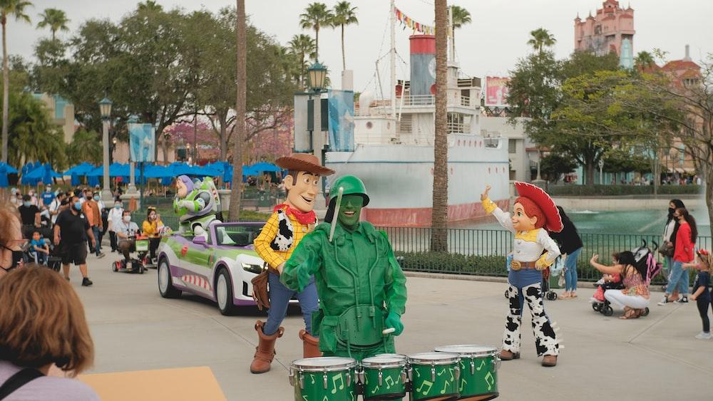 man in green jacket standing beside man in green jacket